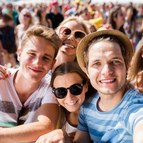 Group of young friends enjoying a festival